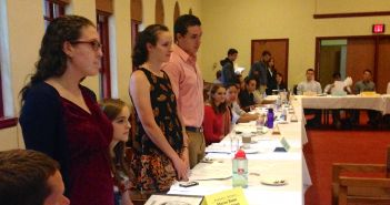 New members of the Student Senate, Eden Weinflash, '17, Katerina Traut, '17, and Logan Herr, '18 stand and introduce themselves to the other members of Student Senate XXVII on Tuesday, Oct. 14. President Kerry Mallett affirmed six new members of Student Senate during the meeting.