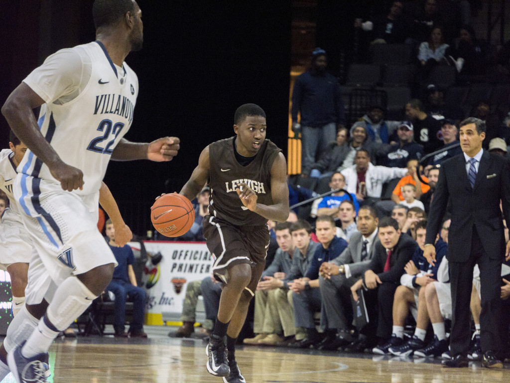 Sophomore guard Austin Price dribbles down the court at the Lehigh Men's Basketball game against Villanova on Friday, Nov. 14, 2014. The Mountain Hawks lost to No. 12 Villanova, 77-66.