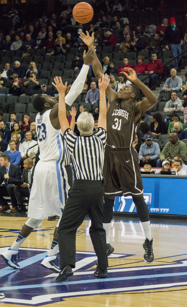 Junior forward Jesse Chuku goes for the ball in the opening tip in the Lehigh men's basketball game against Villanova on Friday, Nov. 14, 2014. The Mountain Hawks lost to No. 12 Villanova, 77-66.(Chris Barry/B&W photo)