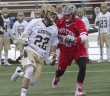 Ian Strain, '17, a midfielder on the men's lacrosse team, runs the ball down the field. This was the first Patriot League game of the season and the Hawks beat Boston University 10-9. (Liz Cornell/B&W photo)