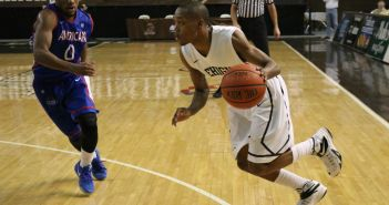 Freshman point guard Kahron Ross faces off against an American University player at Stabler Arena on March 5, 2015. The Mountan Hawks lost 68-62 and were eliminated from the Patriot League tournament. (Samantha Tomaszewski/B&W Photo)