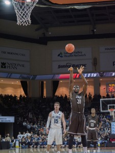 Junior forward Jesse Chuku attempts a foul shot while sophomore guard Miles Simelton watches at the Lehigh men's basketball game against Villanova on Friday, Nov. 14, 2014. The Mountain Hawks lost to No. 12 Villanova, 77-66. (Chris Barry/B&W photo)