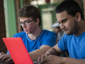 Georgi Georgiev, '17, and Nur Jahangir, '16, work on their program at the rVibe & Coding the Future Hackathon in Sayre Park Lodge on Saturday, Apr. 25, 2015. The event, co-hosted by rVibe, a local start-up, and the Code for the Future House, offered prizes including internship interviews, tablets, and hard drives. (Chris Barry/B&W Photo)