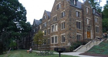 Ari Goret, '14, relaxes in front of Richards House on Tuesday, Sept. 2, 2014. Richards is a first-year residence hall.