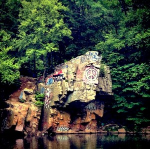 The 35-foot-tall Peace Rock boasts colorful graffiti near Port Clinton, Pennsylvania. (Nadine Elsayed / B&W photo)