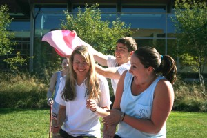 Emma Bolla, '16, left, and Sara Lampert, '18, get slimed by Shane Wolfe, '17, at the Slime a Zeta event on the STEPS lawn on Tuesday, Sept. 15, 2015. The proceeds from Slime a Zeta go to the Zeta Tau Alpha Foundation to support breast cancer awareness and education. (Gaby Morera/B&W Photo)