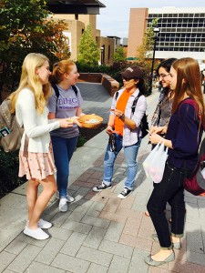 Madison Williams '18 and Emily Ryan '18 handing out buttons and chocolate on campus for Love Your Body Day on Thurs. Oct. 22, 2015. Organized by the Women's Center, this campaign aims to boost self confidence and accept your body. (Joanna Targowski/B&W Photo)