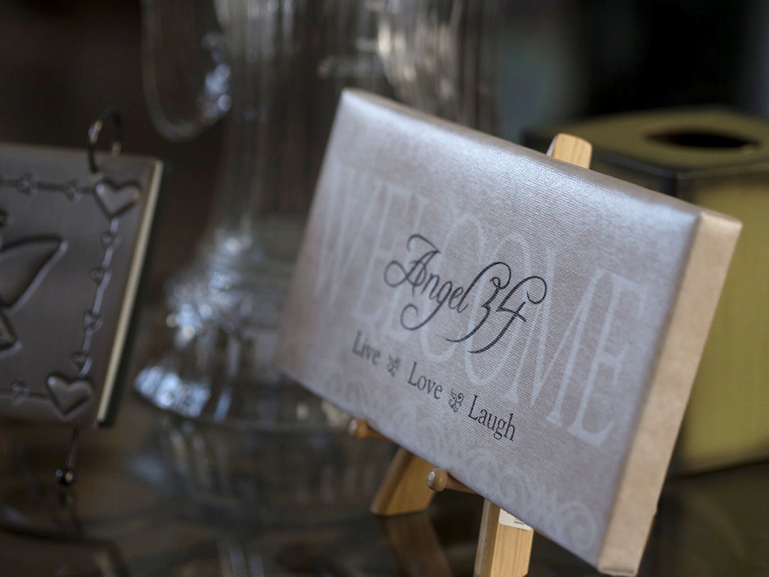 An Angel 34 plaque rests on a table in the Angel Field, Angel 34's headquarters. Nicole Sheriff founded the organization before she lost her battle to cancer, and her parents have led the foundation in her memory since her passing.