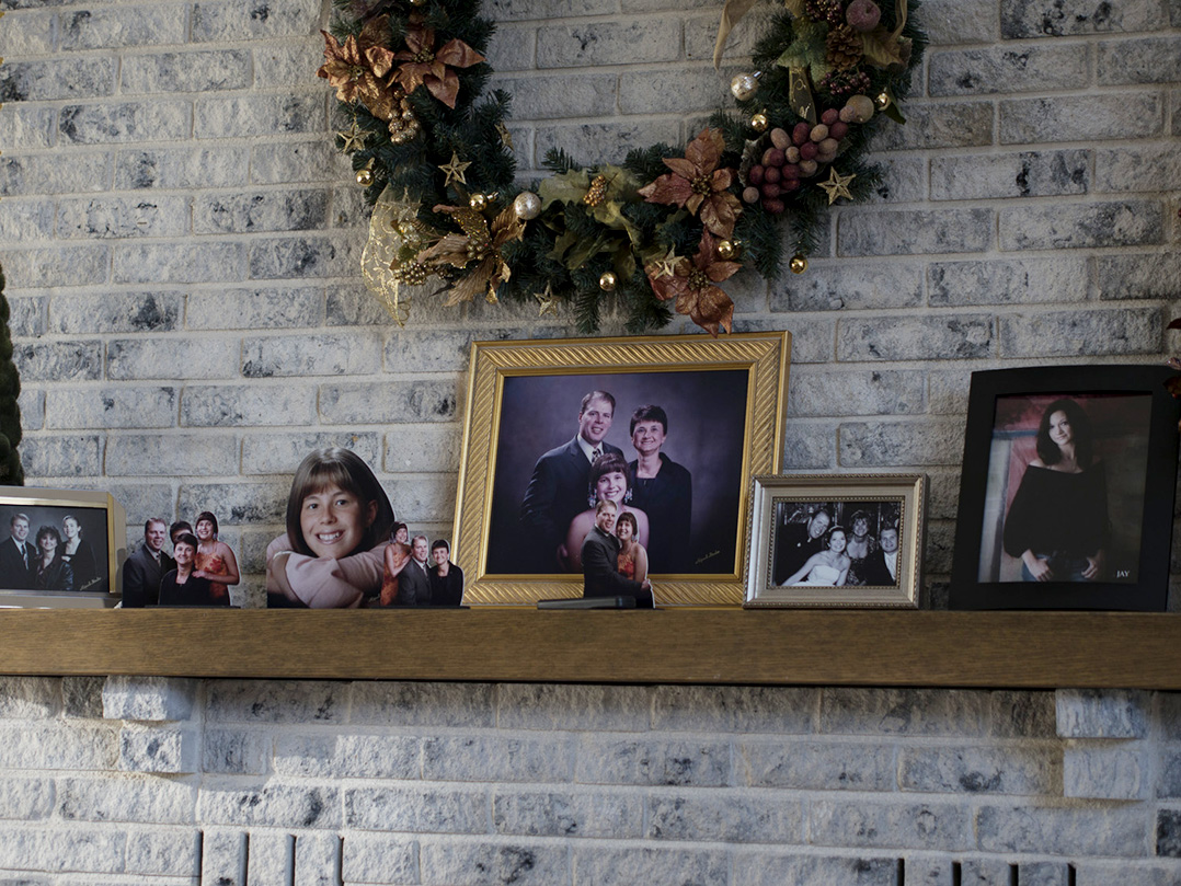 Photos of Nicole Sheriff and her family rest on a mantle in Founder's Hall, the main social space in the Angel Field. Founder's Hall is named in honor of Nicole Sheriff.
