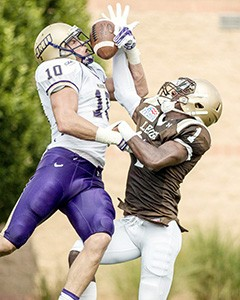 Senior defensive back Olivier Rigaud intercepts a pass against James Madison University's redshirt-senior wide receiver Daniel Brown at Goodman Stadium on Saturday, Sept. 6th 2014 at the Lehigh Football game. Lehigh is currently 5-5 overall and 3-2 in Patriot League play. (Andrew Garrison/B&W Photo)