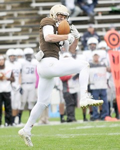Sophomore wide receiver Troy Pelletier jumps to make a catch in a game against Yale University on Saturday, October 3, 2015. Pelletier finished the game with 10 catches for 104 yards. (Austin Vitelli/B&W Staff)
