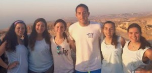 From left: Sofie Coopersmith, '16, Lindsey Sokol, '17, Lindsay Levin, '17, Jon Cohen, '15, Emily Burch, '18 and Michelle Gorson, '18, watch the sunrise together at Masada, Israel in May 2015. (Courtesy of Sofie Coopersmith)