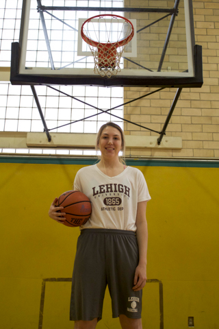 Forward Lexi Martins, '16, stands under the basket at Taylor Gym on Wednesday, Feb. 10, 2016. Martins will have one year left of athletic eligibility, and she'll play at George Washington University. (Brandon Ortiz/B&W Staff)