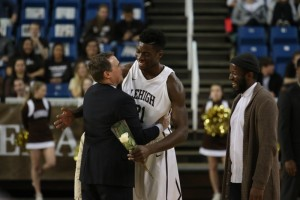 Senior Jesse Chuku hugs Coach Brett Reed during Lehigh men's basketball senior day on Sunday, Feb. 21, 2016. The Mountain Hawks defeated Lafayette in their last home game of league play at Stabler Arena. (Gracie Chavers/BW staff)