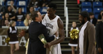 Senior Jesse Chuku hugs Coach Brett Reed during Lehigh men's basketball senior day on Sunday, Feb. 21, 2016. Chuku will continue his basketball career after Lehigh with Greek team Kolossos Rodou B.C. (Gracie Chavers/BW staff)