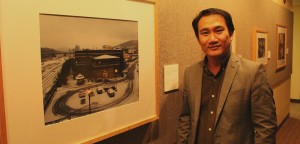 Sothy Eng, an education professor of practice at Lehigh and a photographer, stands next to his photo, Bethlehem on a Snow Day 2012/2013 on Wednesday, Feb. 24, 2016. His photo along with many others were presented at the showcase Revisiting South Bethlehem. (Brandon Griffin/B&W Staff)