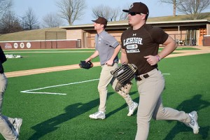 Lehigh juniors David Young Stephen Fitzgerald jog over to warm up with their teammates at baseball practice Tuesday, Mar. 8, 2016 at Legacy Park. Lehigh Baseball will play Villanova University Wednesday March 9, 2016. (Kendall Coughlin/B&W Staff)