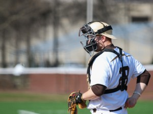 Junior catcher John Scarr adjusts his mask at the Lehigh vs NYIT baseball game on Tuesday, March 23, 2016 at Legacy Field. This was Scarr's first game post-surgery home game against New York Institute of Technology, with the Mountain Hawks winning 10-6. (Austin Vitelli/B&W Staff)