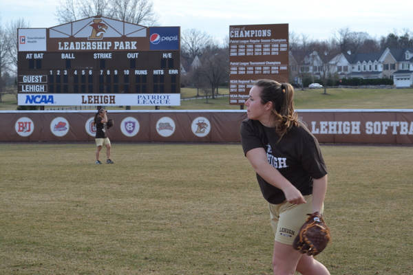 Junior pitcher Christine Campbell has a catch with teammates during practice on Thursday, March 10, 2016, at Leadership Park. The softball team is preparing to play Lafayette College on Saturday, March 26, 2016, at home. (Kendall Coughlin/B&W Staff)