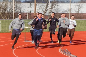 Members of the track team round the corner during their practice on Monday, March 21, 2016. The team is coming back from Spring Break ready to compete outdoors. (Gracie Chavers/B&W Staff)