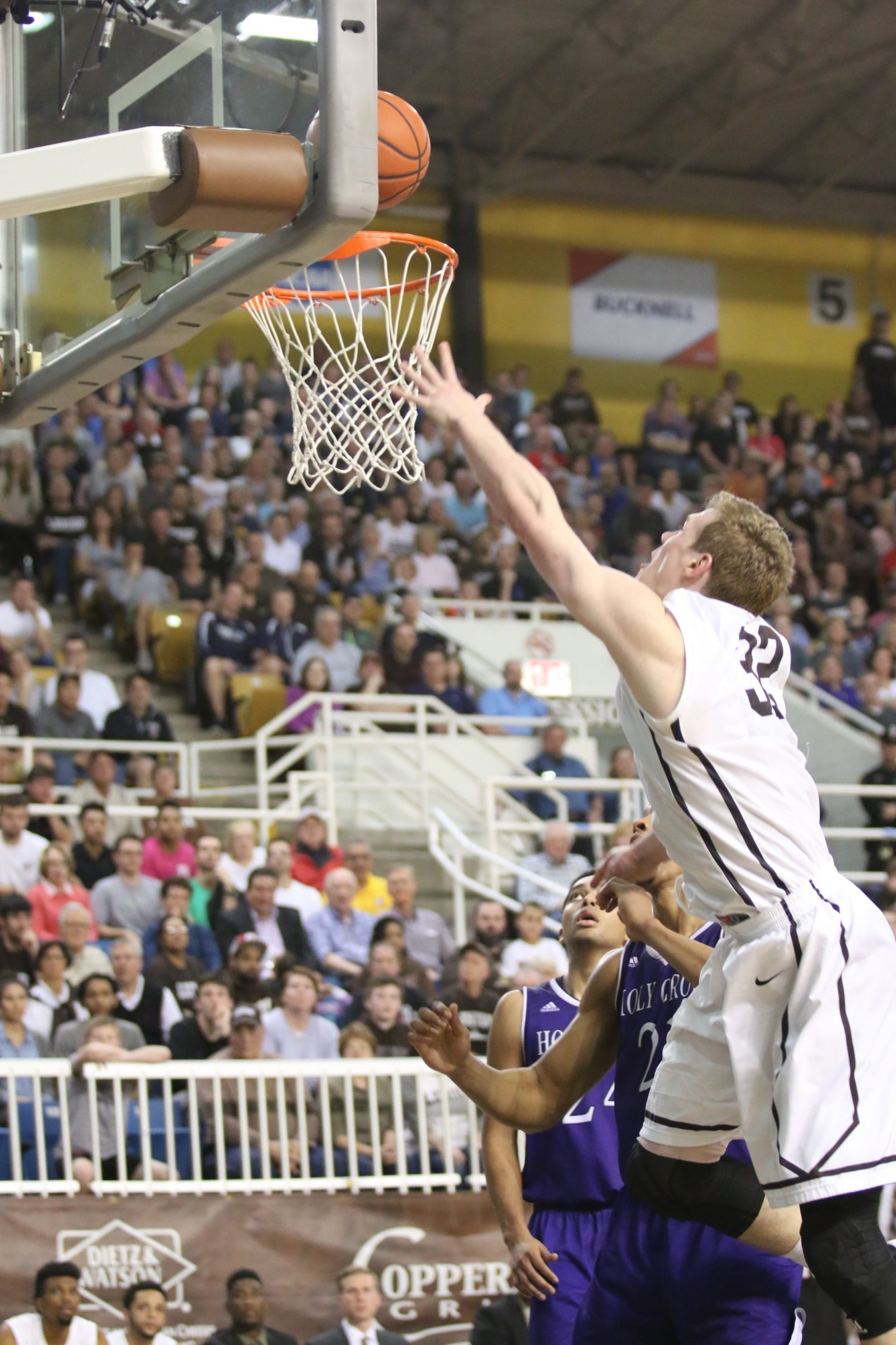 Lehigh junior Tim Kempton reaches high to get the ball to the basket in the Patriot League Championship game Wednesday, March 9, 2016. The Mountain Hawks fell to Holy Cross 56-59. (Gracie Chavers/BW staff)