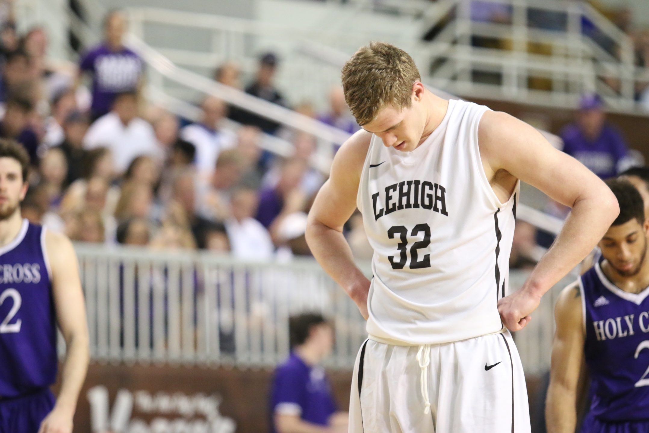 Lehigh junior Tim Kempton sinks his head in defeat after the Patriot League Championship game on Wednesday, March 9, 2016. The Mountain Hawks lost a tough battle to Holy Cross, losing 56-59. (Gracie Chavers/BW staff)