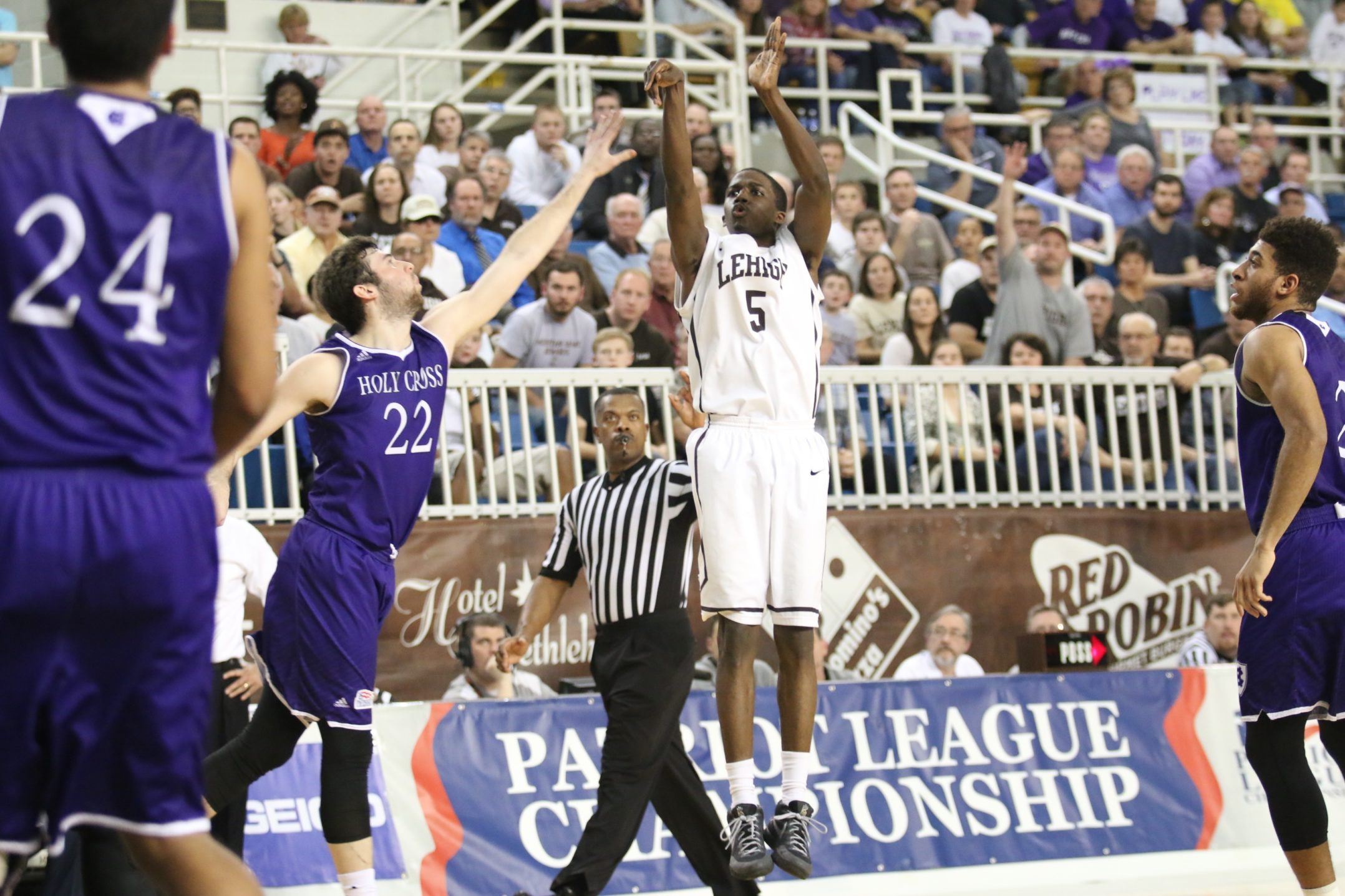 Lehigh junior Austin Price jumps and shoots for three in a heartbreaking loss against Holy Cross in the Patriot League championship game on Wednesday, March 9, 2016. The Mountain Hawks fell to the Crusaders 56-59, ending their season. (Gracie Chavers/BW staff)