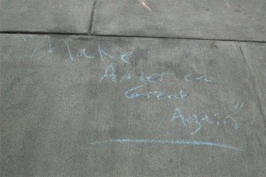 """""""Make America Great Again"""" Donald Trump's campaign slogan, has been written around campus in chalk. Trump has become a controversial figure over the year, with vocal supporters and detractors all across the country and on campus. (Michael Ioannou/B&W Photo)"""