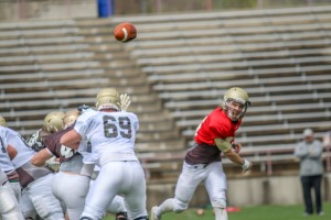 Sophomore quarterback Brendan Craven throws a pass during the annual spring football game at Goodman Stadium Saturday, April 23, 2016. The offense lost to the defense 33-19. (Gaby Morera/B&W Staff)