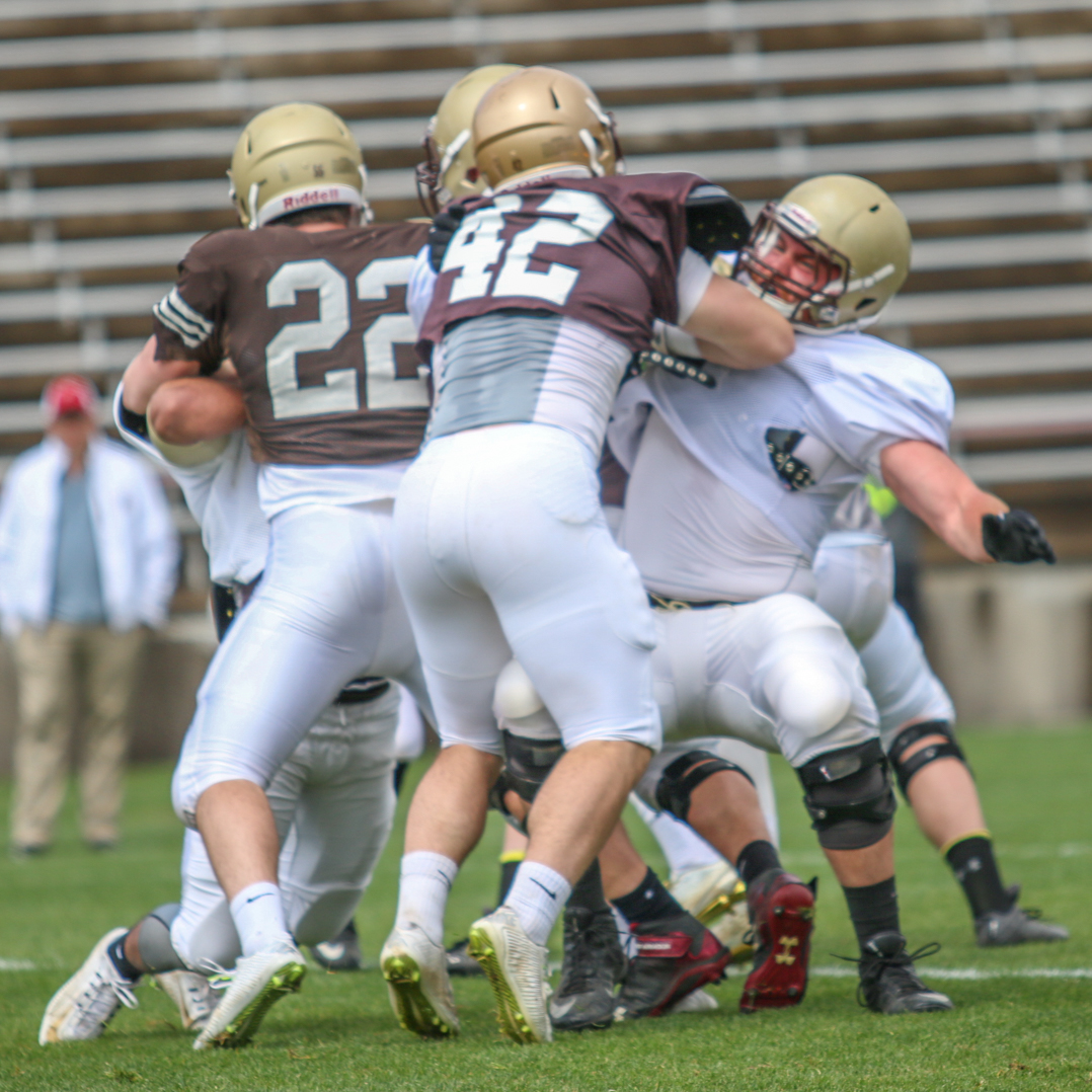 Junior linebacker Evan Kauffman fights through an offensive lineman in the Brown and White spring football game at Goodman Stadium on Saturday, April 23, 2016. Kauffman finished the game with two sacks. (Gaby Morera/B&W Staff)