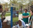 Students gather around outside STEPS building to view a live hawk at the Earth Day event on Friday, April 22, 2016. Other animals, including a skunk and snake, were also shown to students in order to raise awareness for the environment. (Hayley Pochtar/B&W Staff)