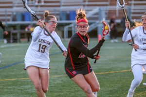 Freshman midfielder/attacker Jane Henderson defends against a Rutgers University player in a game on Tuesday, April 5, 2016, at the Ulrich Sports Complex. Lehigh won the game 9-5. (Austin Vitelli/B&W Staff)