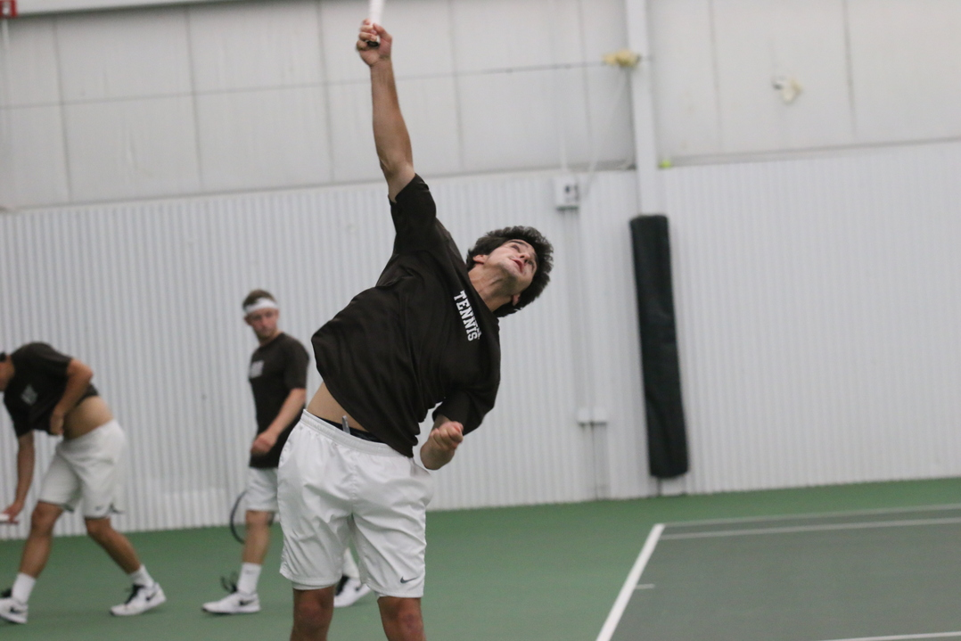 Junior Colin Nardella swings through a serve against Colgate University on Friday, April 29 at the Lewis Tennis Center. Nardella won his singles match 6-7 (3), 7-5, 6-0. (Musa Jamshed/B&W Staff)