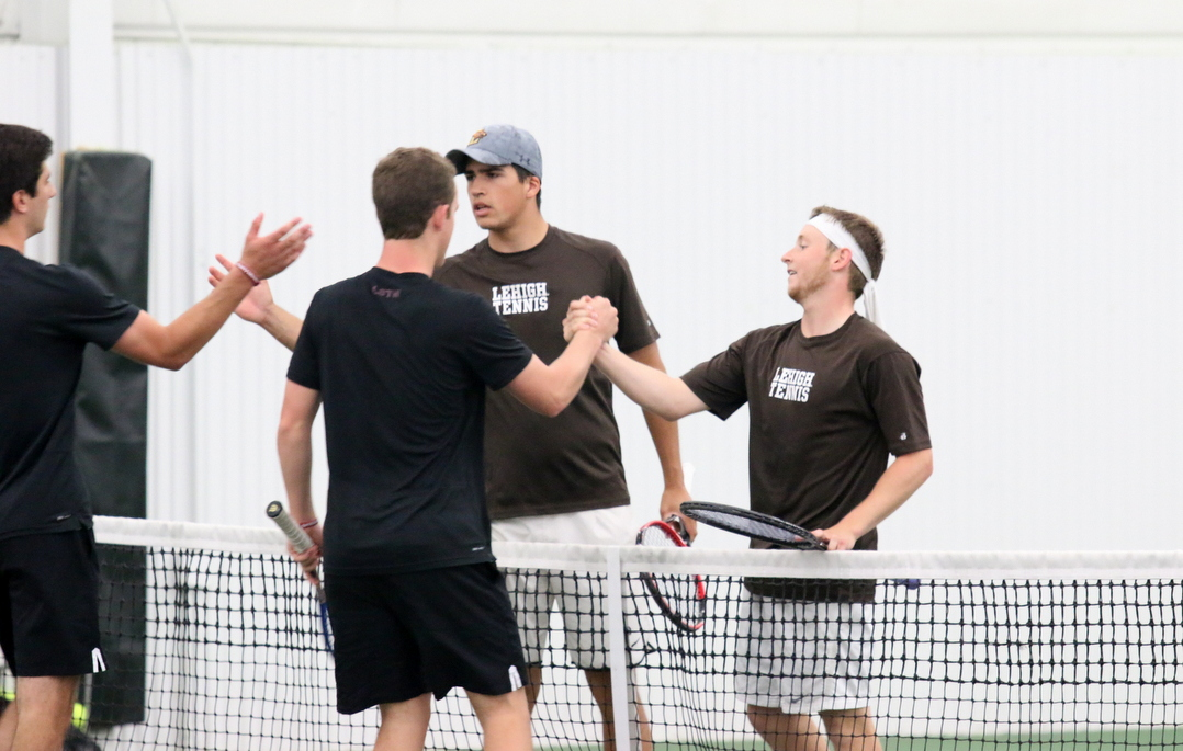 Freshman George Cooper and sophomore Jack Petersen shake hands with their opponents after losing a doubles match by a score of 7-5 to Colgate University in the Patriot League quarterfinals on Friday, April 29, 2016, at the Lewis Tennis Center. The loss conceded the overall doubles point to Colgate in the dual. (Musa Jamshed/B&W Staff)