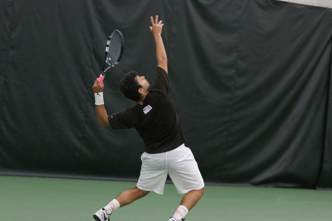 Senior captain Jeremy Kochman tosses the ball up to serve in a singles match against Colgate University in the Patriot League quarterfinals on Friday, April 29, 2016, at the Lewis Tennis Center. At No. 1 singles, Kochman won his match 6-4, 0-6, 6-4. (Musa Jamshed/B&W Staff)