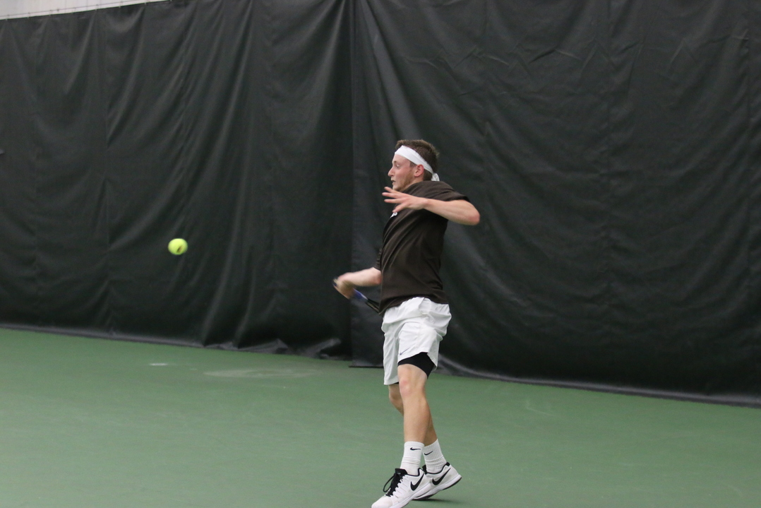 Sophomore Jack Petersen winds up for a forehand shot during his singles match in the Patriot League quarterfinals against Colgate University on Friday, April 29, 2016, at the Lewis Tennis Center. Peterson defeated Colgate's Nick Laub 6-4, 7-5. (Musa Jamshed/B&W Staff)