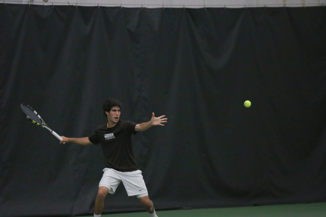 Junior Colin Nardella hits a forehand shot in his three-set victory against Colgate University in the Patriot League quarterfinals on Friday, April 29, 2016, at the Lewis Tennis Center. Lehigh will face Navy in the Patriot League semifinals. (Musa Jamshed/B&W Staff)