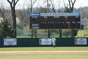 Captured by Tony, Ant squares up in left field for his first game at Lehigh in 2012. His father's 1984 ECC Championship banner hangs to his left.