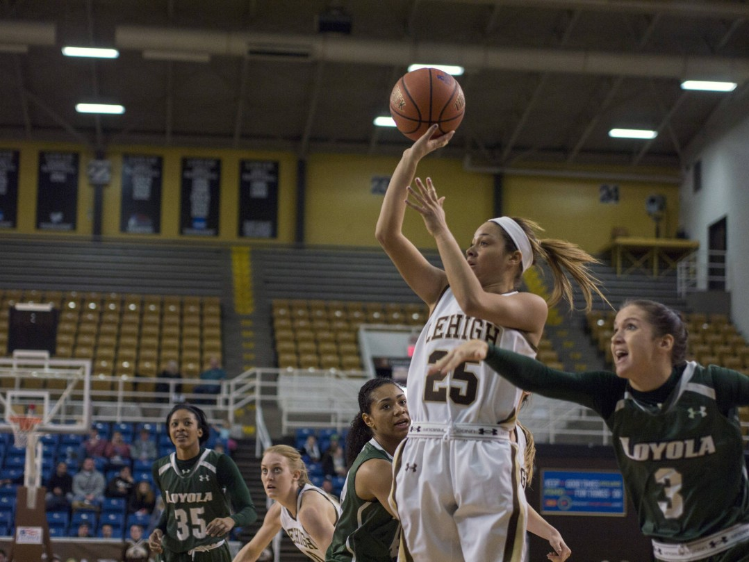 Sophomore guard Kayla Burton attempts to shoot a basket at Stabler Arena on Saturday, Feb. 7, 2015. The Mountain Hawks won 75-61. (Chris Barry/B&W photo)