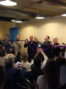 Adrian Shanker, founder and executive director, cuts the ribbon at the openign ceremony of the Bradbury-Sullivan LGBT Community Center on Saturday, April 9, 2016.The center is located in Allentown. (Courtesy of Adrian Shanker)