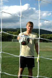 Senior goal keeper Jacob Gottwald poses in the goal Friday, Sept. 9, 2016 at the Ulrich Sports Complex. Gottwald started the season with six saves at the opening game. ( Annie Henry/B&W Staff)