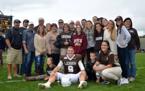 Lehigh quarterback Nick Shafnisky posing with over 20 members of family and friends who to the home football game against Colgate on Sunday, Oct. 8, 2016, at Goodman Stadium. Shafnisky's mom and dad have never missed one of his football games. (Annie Henry/B&W Staff)