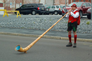 A festive man plays the alphorn outside of the Oktoberfest tents, entertaining those who passed by on Saturday, Oct. 1, 2016. Oktoberfest brings a European spirit to Bethlehem with many of the acts that perform. (Danielle Bettermann/B&W Staff)
