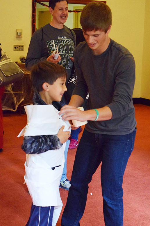 Rob Smith, '19, wraps a trick or treater at the make yourself a mummy station in the University Center on Sunday, Oct. 23, 2016. Many local Bethlehem families brought their children to Spooktacular, where there were plenty of activities for the children. (Malcolm Scobell/B&W staff)
