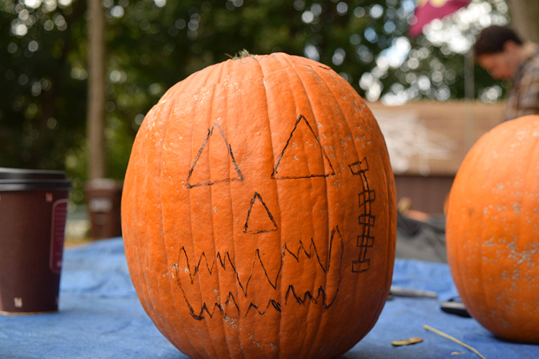 The Spooktacular pumpkin carving at Psi Upsilon was a family favorite for local Bethlehem residents and their children on Sunday, Oct. 23, 2016. Spooktacular was put on by Lehigh's Community Service Office. (Malcolm Scobell/B&W staff)