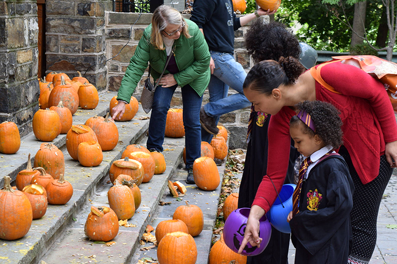 Local Bethlehem families pick out pumpkins for Spooktacular at the University Center on Sunday, Oct. 23, 2016. The children drew the designs and Lehigh students carved it for them. (Malcolm Scobell/B&W)