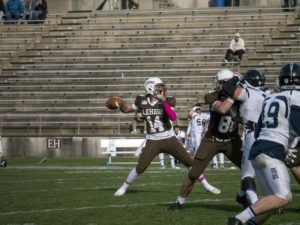Freshman quarterback Brad Mayes prepares to throw the ball downfield at the Lehigh-Georgetown game on Saturday, Oct. 31, 2015. Mayes has split starts with starter Nick Shafnisky this year due to injuries. (Chris Barry/B&W Photo)