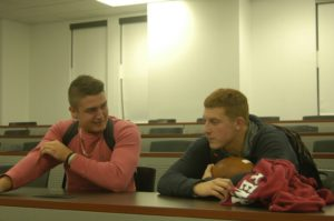 Sophomore quarterback Brad Mayes and senior quarterback Nick Shafnisky discuss the Mountain Hawks' performance this season. Mayes is poised to take over as starting quarterback for the team next year. (Alek Mosholt/B&W Staff)