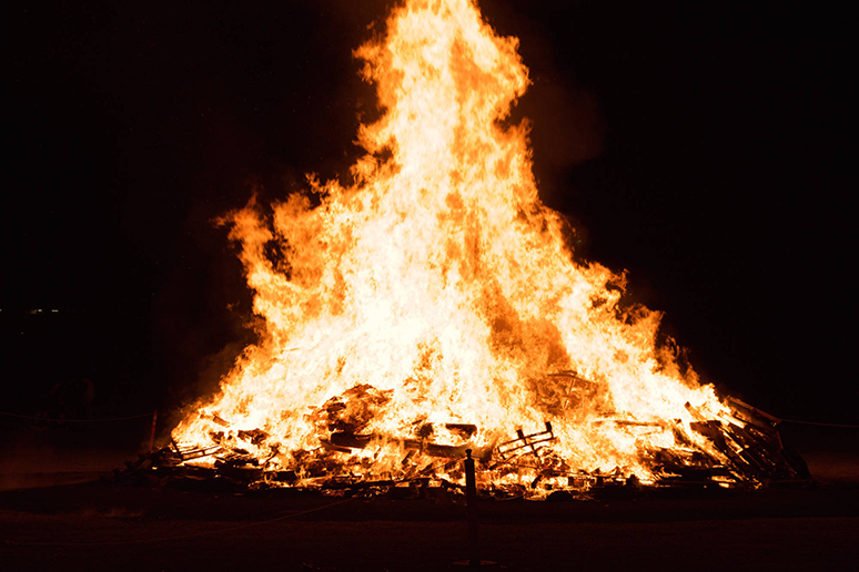 Flames burn the crates piled at the Lehigh After Dark event Slow Burn at Goodman Campus on Thursday, November 17, 2016. The event hosted hundreds of students and community members. (Sarah Epstein/B&W Staff)