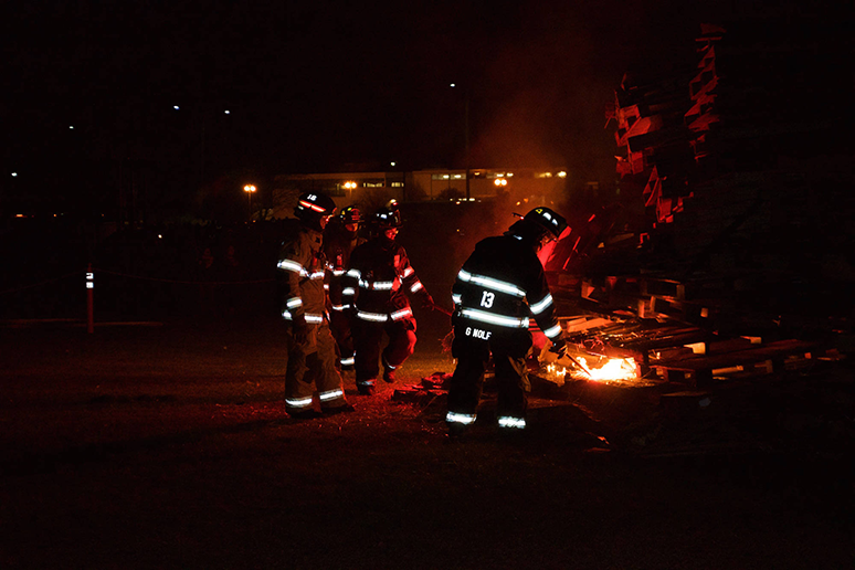 Members of the Lower Saucon Fire Department set a mound of wooden crates on fire at the Lehigh After Dark event Slow Burn at Goodman Campus on Thursday, November 17, 2016. The event is in preparation for the Lehigh-Lafayette football game, being played Saturday, November 19, 2016. (Sarah Epstein/B&W Staff)
